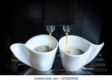 The coffee maker and two cups