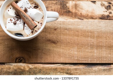 Coffee with marshmallows, coffee beans and cinnamon