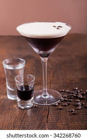Coffee Martini cocktail on wooden background
