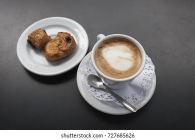 Coffee with milk. Cortado, Croissant with chocolate. Bakery products