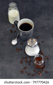 coffee, milk and sugar on  grey background