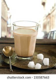 Coffee with milk and sugar, selective focus