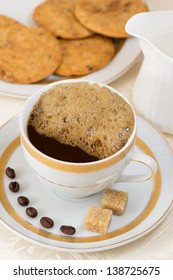Coffee, more cream, biscuits, brown sugar cubes and coffee beans