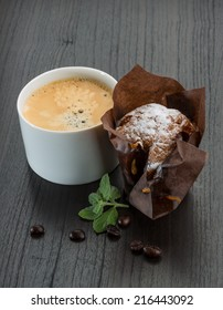 Coffee with muffin and mint leaves