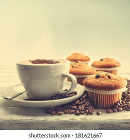 coffee and muffins with coffee beans