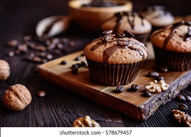Coffee muffins with grated walnut and topped with chocolate