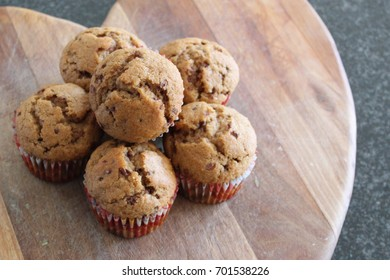Coffee Muffins Sitting on a Wooden Board