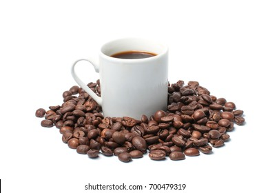 Coffee mug with coffee and coffee beans on a white background