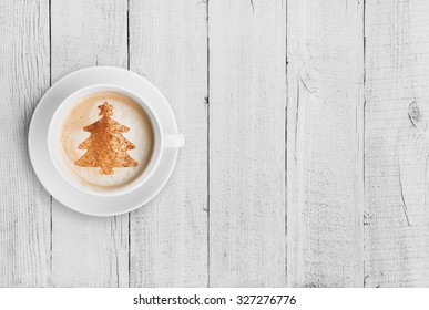 coffee mug with christmas tree shape on white wood table