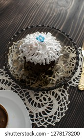 Coffee mug with cupcake  on rustic table from above