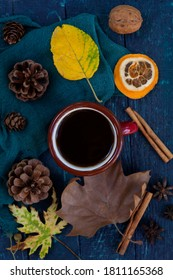 Coffee mug decorated with autumn concept on top view.