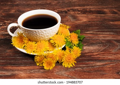 Coffee mug with flowers on wooden background