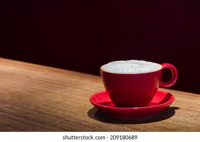 coffee mug with frothed milk at the bar