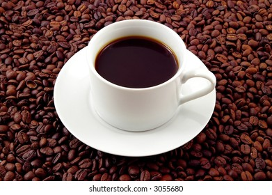 Coffee mug on a bed of coffee beans