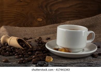 Coffee mug on rustic background. Cup of strong coffee. Coffee break.