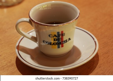 Coffee mug on a table with a colombian flag on it