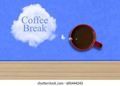 Coffee mug on table with text Coffee Break