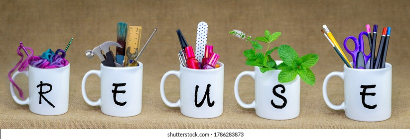Coffee mugs being reused with reuse text, recycle and upcycle for sustainable living and zero waste
