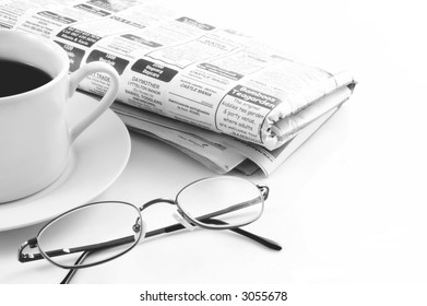 Coffee with newspaper and reading glasses