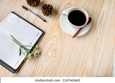 Coffee with a note on a wooden desk