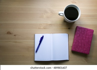 coffee and notes for a bible study on desk