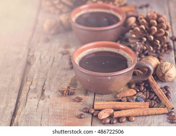 Coffee, nuts, cones, cozy knitted blanket. Winter, New Year, Christmas still life.