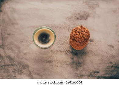 Coffee and oatmeal cookie on vintage watercolor background. Film effect