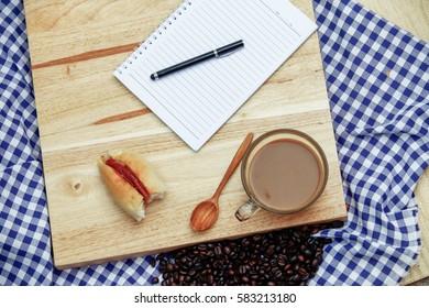 Coffee on grunge wooden background texture note