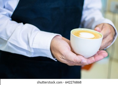 Coffee on hand holding for serve.