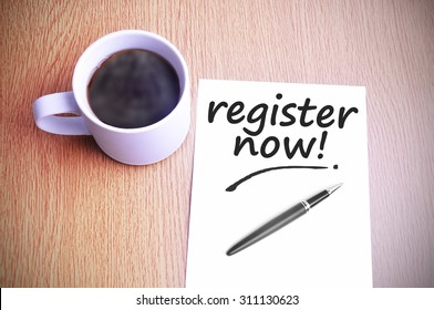 Coffee on the table with note writing register now.