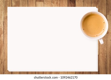 Coffee on white paper on wooden background