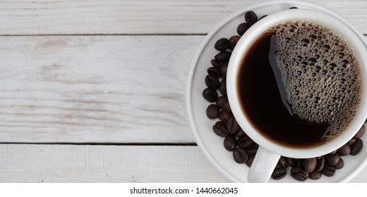 Coffee on white wooden textured background, banner concept