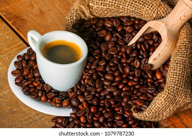 coffee on wood background, with bean