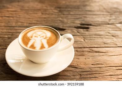 Coffee on wood table , soft focus