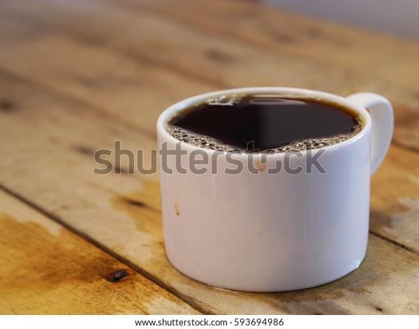 Coffee on wooden floor