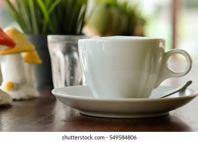 Coffee on wooden table and nature background