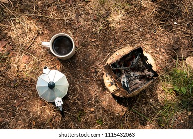 Coffee in the outdoors. Portable wood stove and coffee percolator in the woods.