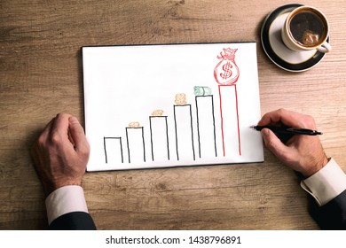 Coffee and paper with business growing graph with money sketch on top
