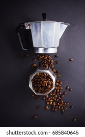 Coffee percolator and coffee beans on dark background