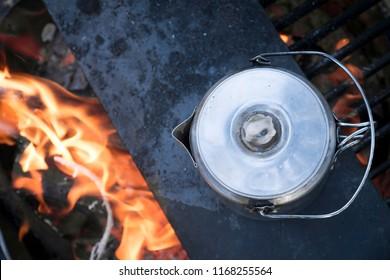 Coffee percolator over campfire