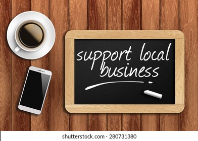 coffee, phone and chalkboard with make support local business words.