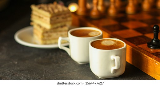 coffee, piece of cake (festive atmosphere, chess, Christmas lights, new year) menu concept. food background. top view. copy space