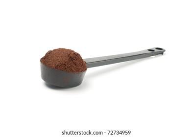 Coffee in  plastic  spoonon  white background