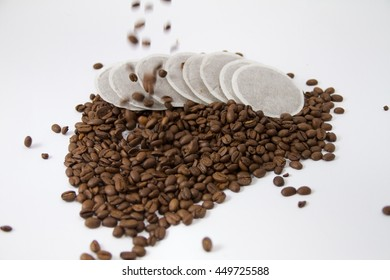 Coffee pods with falling coffee beans