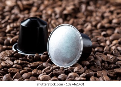 Coffee pods on coffee beans or capsula de cafe