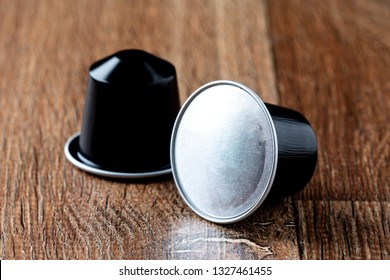 Coffee pods on wooden table or capsula de cafe