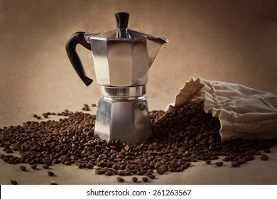 Coffee pot and coffee beans. Paper texture coffee. Dark coffee roasted. Bag of coffee, spill. Coffee beans