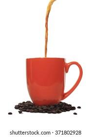 Coffee pouring into red mug