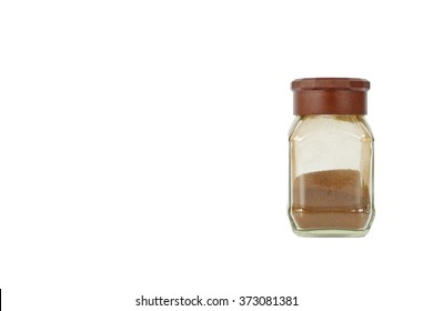 coffee powder in a brown capped glass jar. white background. standing position. copy space on the left