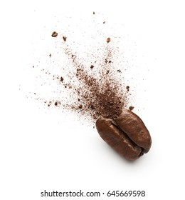 Coffee powder burst from coffee bean isolated on white background